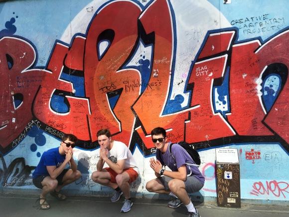 bravo boys with berlin mural